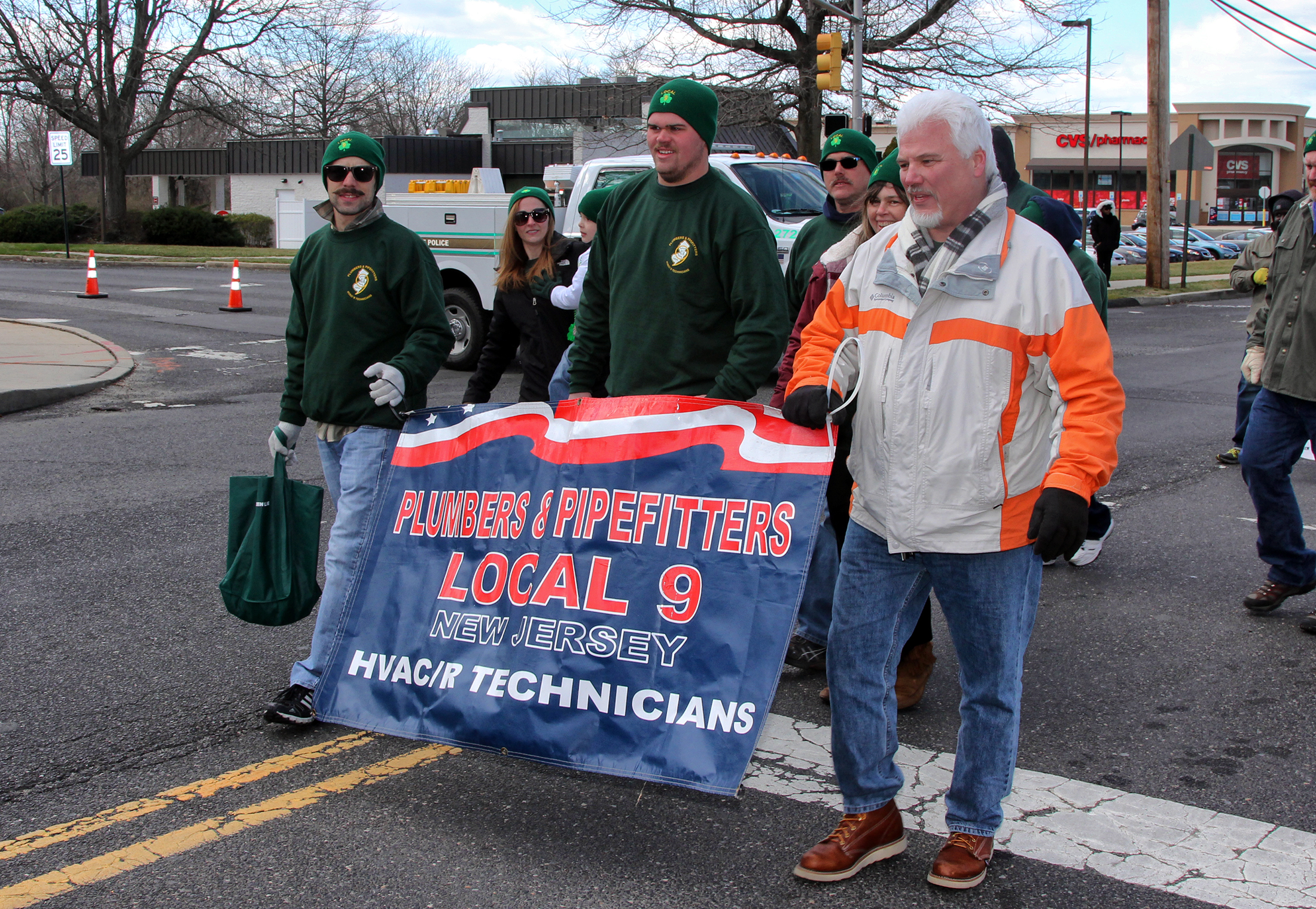 banner forLocal 9 Plumbers and Pipefitters at the 2017 St Patrick's day parade